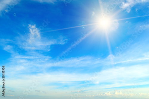 Fototapeta Couds in the blue sky. Bright sun illuminates the space. obraz na płótnie