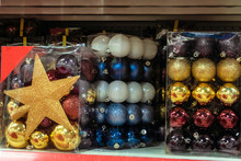 Christmas Balls Sets Of Toys On A Shelf In Shop Market. Holiday Sales.