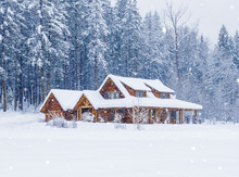 Rural Country Vacation House Home In Snowy Winter  With Lights On And Snowing