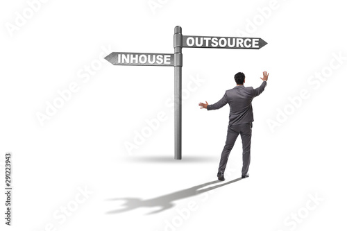 Fotografía Businessman at crossroads deciding between outsourcing and inhou