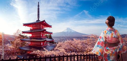 Japanese girl in kimono traitional dress walk in Sakura park with Fuji mountain Wallpaper Mural