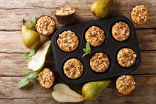 Only From The Oven Pear Muffins With Walnuts, Cinnamon And Nutmeg In A Baking Dish Close-up. Horizontal Top View