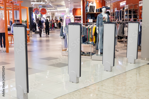 Fotografie, Obraz  Retail shop electronic anti-theft gate system with sensor deters pilferage
