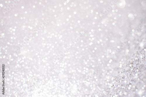Obraz Silver white glittering Christmas lights. Blurred abstract background - fototapety do salonu