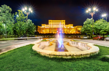 Great night view of Palace of the Parliament. Picturesque evening cityscape of Bucharest city - capital of Transylvania, romaninan, Romania, Europe. Traveling concept background.