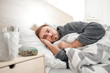 canvas print picture - Man ill with flu lying in bed