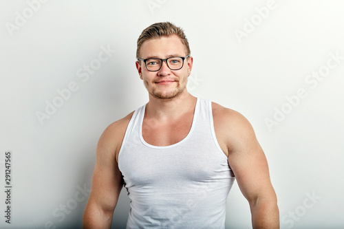 young strong handsome cheerful man in white singlet on white background Tapéta, Fotótapéta