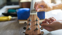 Checking The Acoustic Guitar String, Expert Is Tuning The Guitar String, Close-up