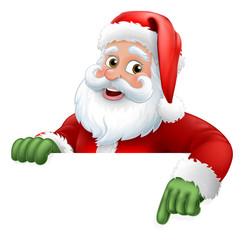Santa Christmas cartoon character peeking over a sign and pointing at it