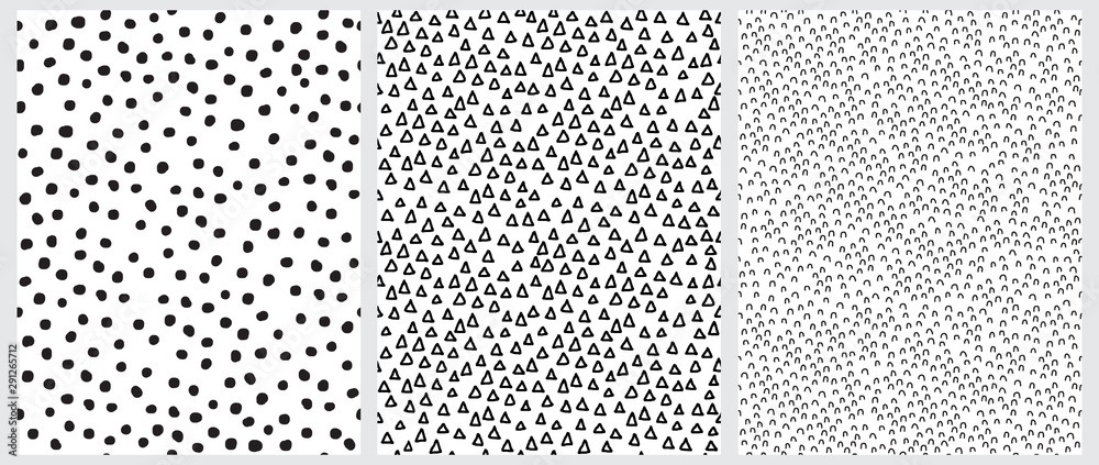 Fototapeta Simple Geometric Irregular Vector Prints Ideal for Fabric, Textile, Wrapping Paper. Abstract Hand Drawn Childish Style Vector Patterns. Black Triangles, Arches and Dots Isolated on a White Background.