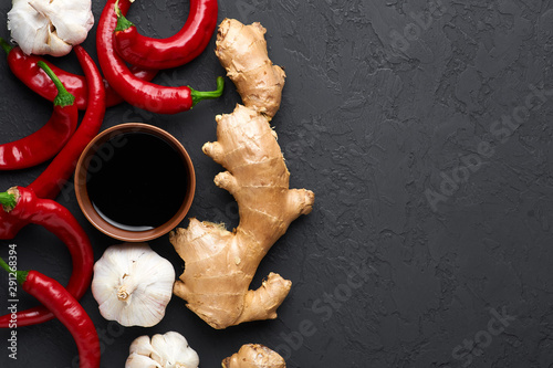 Foto auf AluDibond Hot Chili Peppers Schezwan Sauce ingredients at dark slate background with copy space. Schezwan Sauce is Indo-chinese or Sichuan cuisine hot sauce with red chilli, garlic, ginger and soy sauce.