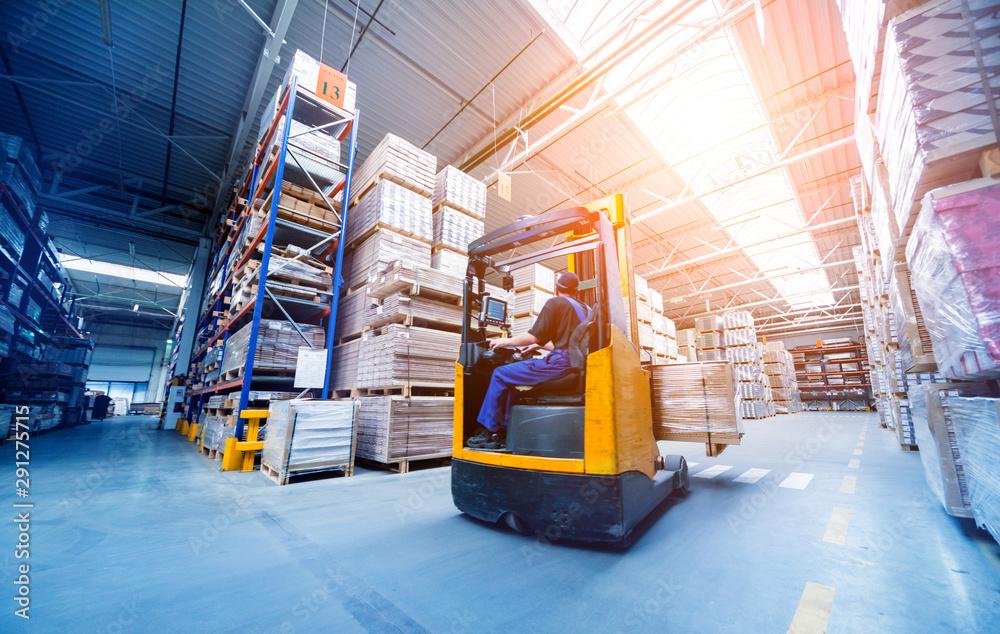 Fototapeta Forklift loader in storage warehouse ship yard. Distribution products. Delivery. Logistics. Transportation.