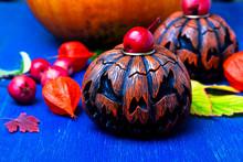 Glowing Halloween Pumpkin Heads Jack O Lantern On Blue  Wooden Background