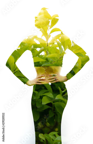 Keuken foto achterwand Spa Double exposure of a fit girl with her hands on her waist combined with photograph of bright tropical plants with sun shining through the leaves