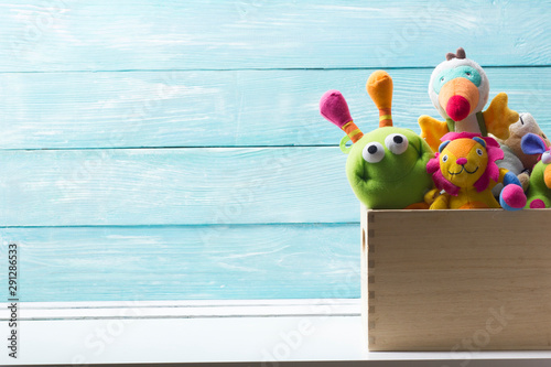 obraz dibond Toys collection in box on abstract wooden background. Donatation. Copy space for text