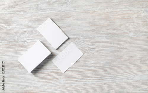 Cuadros en Lienzo  Photo of blank business cards on light wooden background