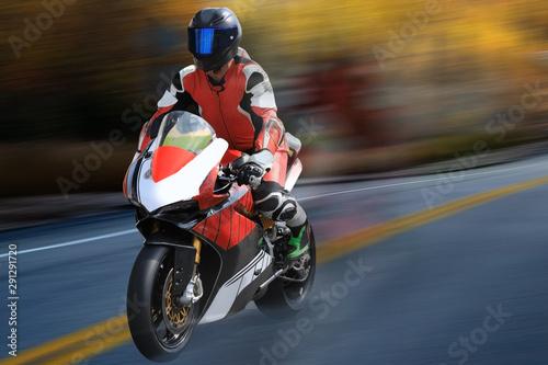 Fényképezés  Motorcycle racer in helmet racing at high speed