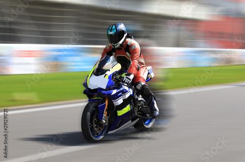 Racer on a sports bike rides on the race track Tapéta, Fotótapéta