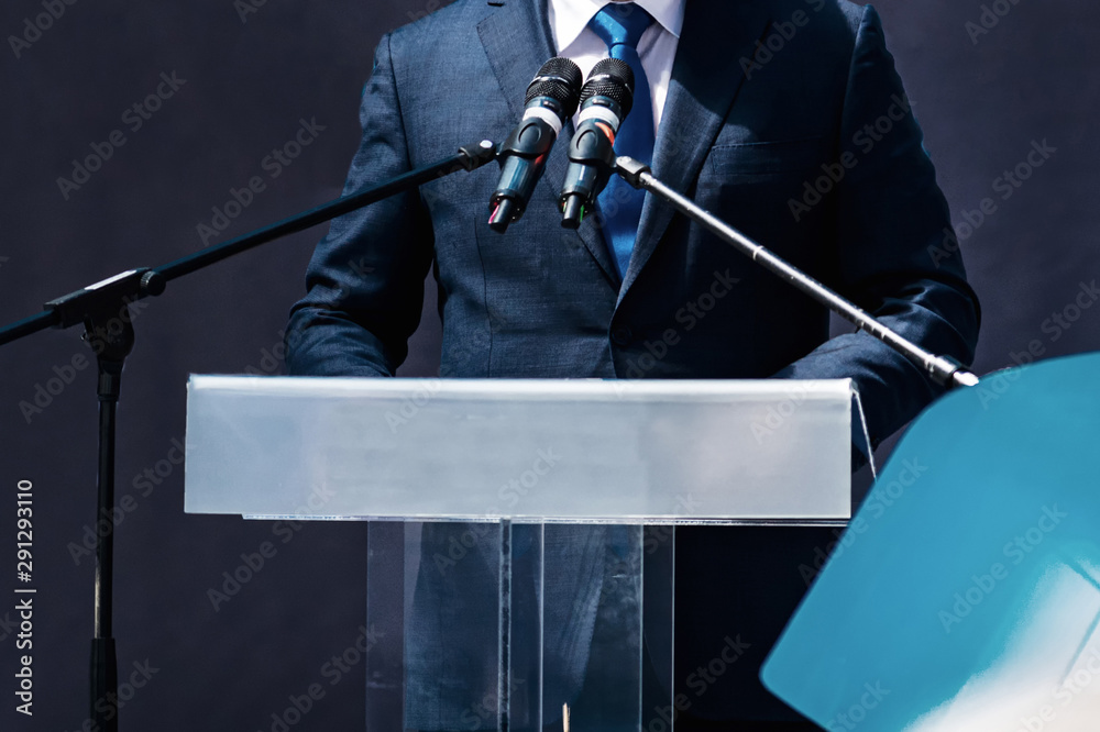 Fototapety, obrazy: Male Speaker Standing In Front Of Microphones