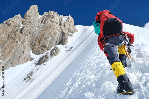 Fototapeta Climber reaches the summit of Everest. National Park, Nepal.