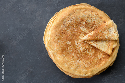 Foto op Canvas Brood Stack of pancakes on dark rustic background, top view