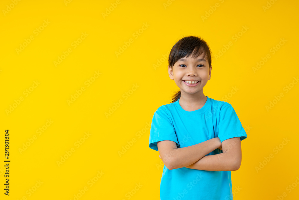 Fototapety, obrazy: Portrait of young Asian confidental girl child and smiled in blue shirt on yellow background in studio