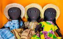 Row Of Rag Dolls Wearing Tradi...