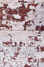 Old Red Brick Wall With Peeling White Paint