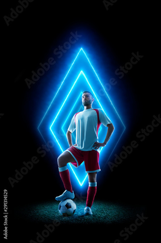 Professional soccer player in neon background Tableau sur Toile