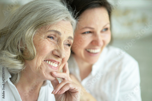 Obraz Portrait of Senior woman with daughter at home - fototapety do salonu
