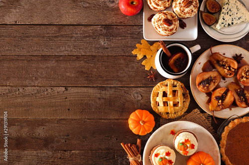Foto op Plexiglas Herfst Autumn food side border. Table scene with a selection of pies, appetizers and desserts. Top view over a rustic wood background. Copy space.