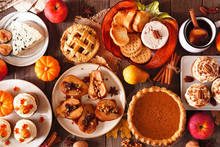 Autumn Food Concept. Selection Of Pies, Appetizers And Desserts. Top View Table Scene Over A Rustic Wood Background.