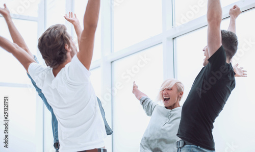 Obraz na plátně  jubilant business team standing in the office