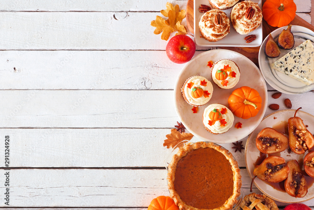 Fototapety, obrazy: Autumn food side border. Table scene with a selection of pies, appetizers and desserts. Top view over a white wood background. Copy space.