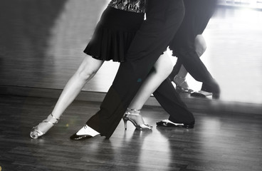 Male and female legs dancing latin rhythms and swing