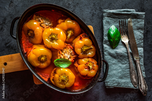 Fototapeta Pepper stuffed with minced meat and rice in tomato sauce. obraz