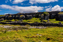 Stunning View Of Cracked Limestone Rocks That Form Grykes By Erosion Between Stone Fences And Green Grass On The Island Of Inis Oirr, Sunny Day In Inisheer, Island In The West Of The Coast Of Ireland