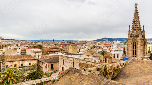 Aerial view of roofs of houses  and the bell towers of an old church in  Barcelo Wallpaper Mural