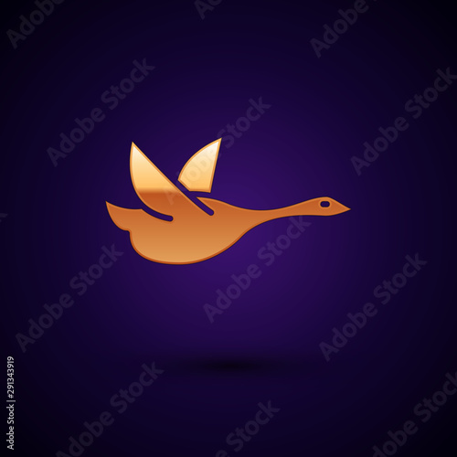 Gold Flying duck icon isolated on dark blue background. Vector Illustration