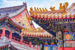 Leinwanddruck Bild - Chinese traditional architecture -  colorful ornament and statue dragons on roof of Lama Temple in Beijing, China