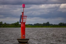 Red Buoy On The Beach