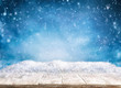 canvas print picture - Beautiful winter background with wooden old desk and blurred blue sky. Winter, New Year and Christmas concept with snowy background.