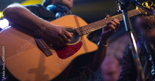 The artist plays the guitar. - 291356934