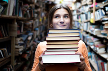 Girl Student Holds A Stack Of ...