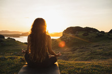 Woman Meditating Yoga Alone At...