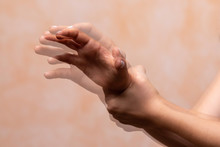 Hands Pain Concept,Closeup View And Motion Blur Of Left Hand Grab Right Hand, Woman Or Man Holding Her Wrist Pain
