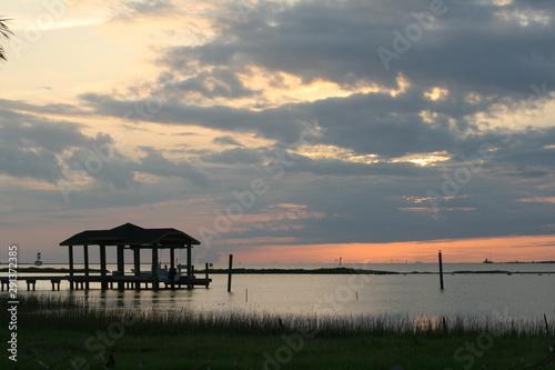Coastal Boathouse at Sunset Fototapeta
