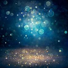 Christmas Defocused - Golden Glitter Dust On Blue Background
