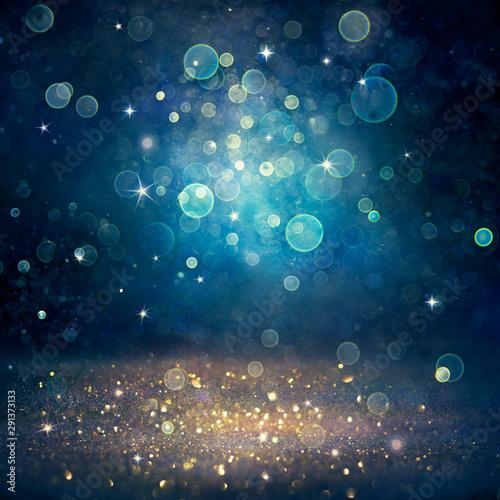 Christmas Defocused - Golden Glitter Dust On Blue Background Canvas-taulu