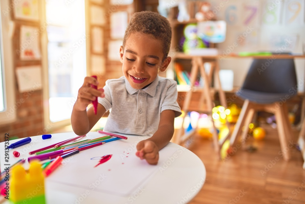 Fototapety, obrazy: Beautiful african american toddler drawing using paper and marker pen smiling at kindergarten